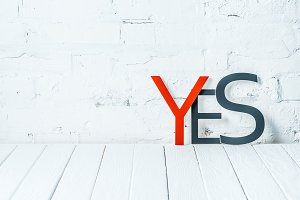"""""""yes"""" lettering with decorative red"""