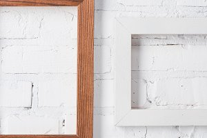 brown and white empty frames hanging