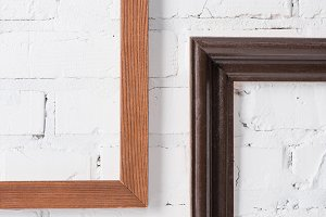 brown and black empty frames hanging