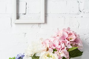 white empty frame on brick wall with
