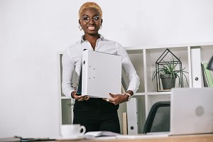 african american businesswoman holdi