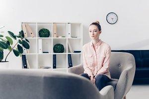 attractive pensive businesswoman sit
