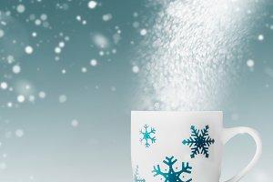 Mug with snowflakes and snow