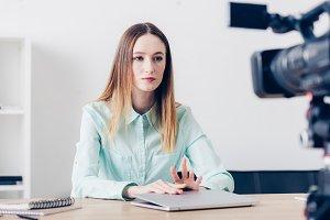attractive female video blogger sitt
