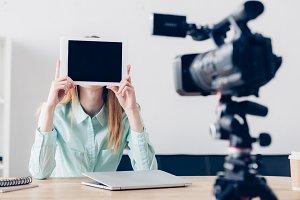 female video blogger recording vlog