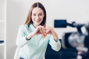 happy attractive female video blogge