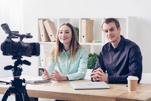 smiling video bloggers recording vlo