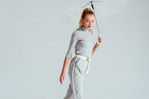 attractive woman in grey clothes pos