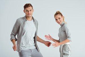 man dancing while smiling woman look
