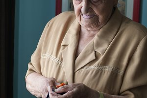 Elderly woman doing needlework