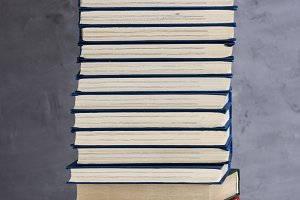 stack of books in a blue cover