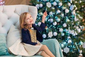 Little girl in a blue jacket sitting