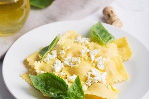 Boiled ravioli with basil, cheese an