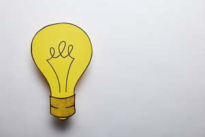 top view of yellow light bulb idea s