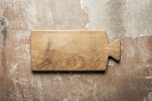 wooden board on rustic background wi