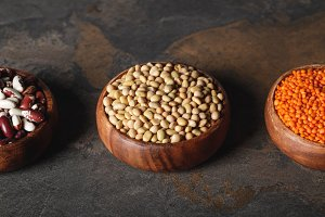 beans, soy and lentils in wooden bow