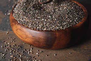 chia seeds in wooden bowl on table s