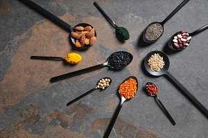 flat lay of spoons with superfoods,