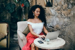 portrait girl using laptop and smart