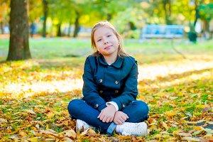 Little girl sitting having fun in an