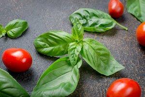 leaves  green basil, cherry tomatoes