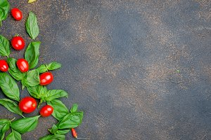 leaves green basil and cherry tomato