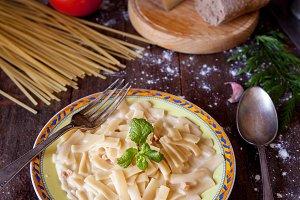 Close up of Carbonara noodles on a r