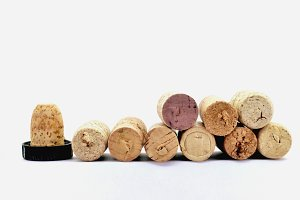 row of hole corks on white