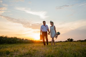 Rustic wedding couple at sunset in