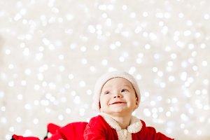 Little Santa baby over defocused