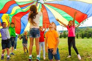 Overjoyed kids bouncing under