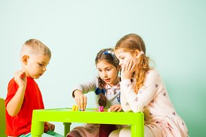 Kids playing board games sitting at