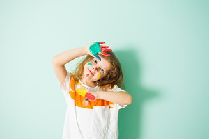 Adorable girl with colorful dots on