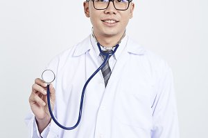 Doctor holding stethoscope on white