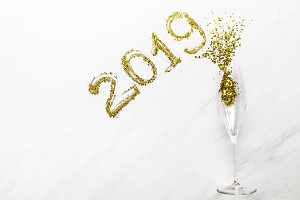 2019 numbers and champagne glass wit