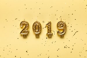 golden 2019 candles and festive conf