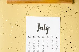 top view of july calendar with golde