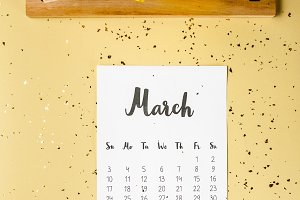 top view of march calendar with gold