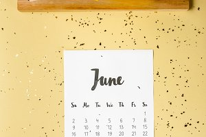 top view of june calendar with golde