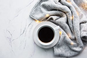 Cup of coffee, scarf and garland