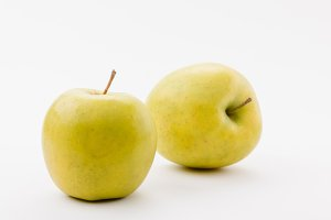 tasty golden delicious apples on whi