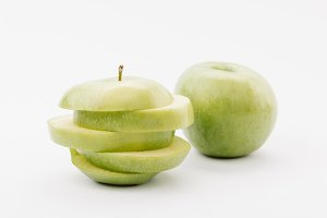 sliced and whole golden delicious ap