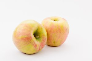 ripe golden delicious apples on whit