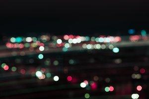 blurred colorful bokeh lights at nig