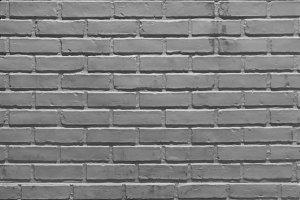 Gray brick wall pattern surface text