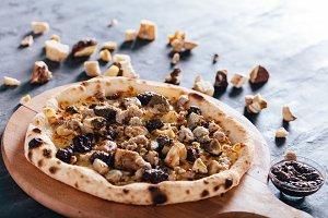 Pizza with porcini mushrooms, sausag