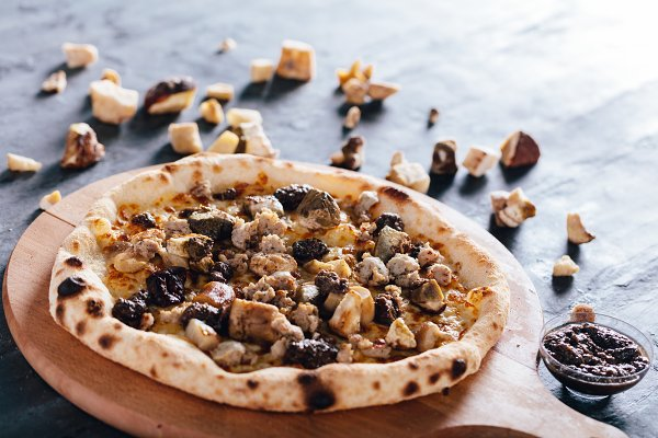Pizza with porcini mushrooms, sausa…