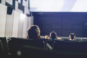 back view of people sit in cinema ha
