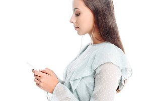 side view of young woman using smart