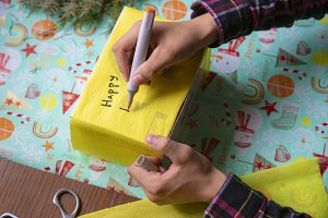 present box writing a wish on a new